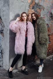 a long coat made of llama hooded