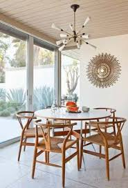 mid century dining room in palm springs clic architecture terrazzo floors sputnik style light wishbone chairs