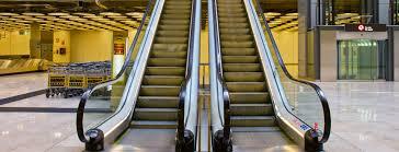 people on escalators. escalators people on c