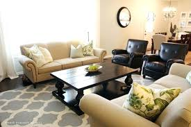 red rug brown couch living room small mirror brown sofa blue rug fancy chandelier striped gray