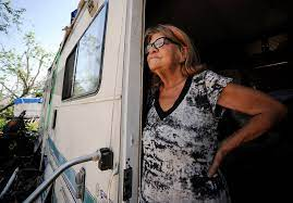 In this May 1, 2019, photo, Janelle Crosby stands in a donated recreational  vehicle where she h …   Las Vegas Review-Journal