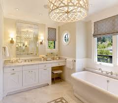 white vanity cabinet and bathroom lighting fixtures with window shades also freestanding tub