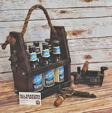 this custom rustic wooden beer holder conveniently includes a metal bottle opener on the side so you won t need to hunt for the bottle opener when you are