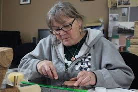 norma pasatieri starts working on a coaster she is making during the eight week leather