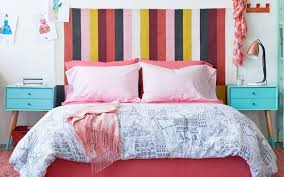 in this bedroom c pink red and aqua are balanced nicely with the neutral white walls and the black white and pale shades in the striped rug that