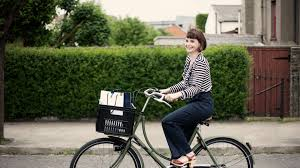 studio atilde deg atilde deg atilde deg  branding lifestyle riding in the street bicycle young w stripes shirt