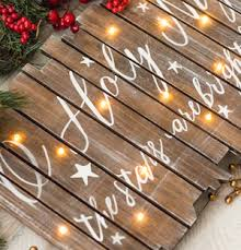 Cozy rustic outdoor christmas decoration ideas Rustic Farmhouse Light Up Christmas Sign Woodenlight Up Sign Painters Tape Wood Stain Acrylic Paint Printed Letters You Could Either Buy The Sign On Sale Or Make Prudent Penny Pincher 150 Rustic Christmas Decor Diy Ideas Prudent Penny Pincher