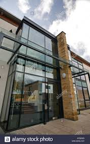 glass exterior modern office. exterior of 2 storey office building reception in a modern business park stock image glass