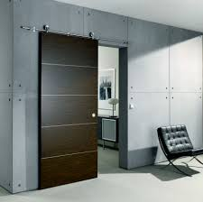 Contemporary Sliding Door from Bartels  an exposed stainless steel rail  system