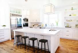 White Kitchen island with Backless Black Metal Counter Stools