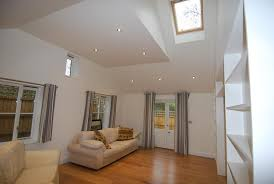 ceiling yellow recessed lights lighting sloping glass