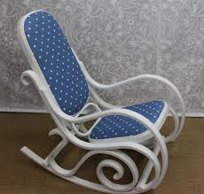 newly up styled bent wood antique rocking chair upholstered in a pretty blue and white polka dot fabric and painted out in a crisp oxford white with a