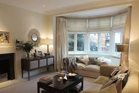 beige living room. #beige Living Room With #dress #curtains - Design By Sarah Assael, Expert Beige