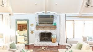 how to mount a flat screen tv above brick fireplace image