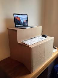 DIY standing desk made using a cardboard box