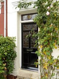 english country front doors. this black victorian style door with leadlighting is perfectly complemented the pink rambling rose. english country front doors
