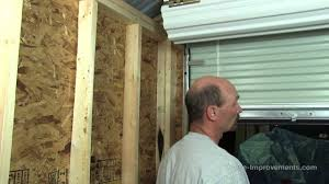 How To Build A Shed - Part 5 Installing A Metal Roll-Up Door - YouTube