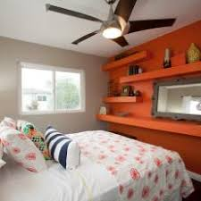 Gray Contemporary Bedroom With Orange Accent Wall