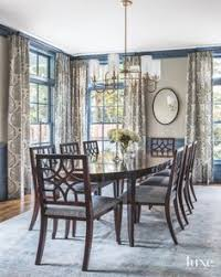 very appealing dining room love the print dries the blue on the seat cushions