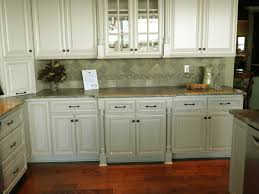 kitchen white wooden kitchen cabinet with glass door and brown counter top plus gray tile