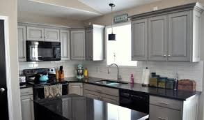 Light Grey Cabinet And Best Black Appliances Using White Backsplash