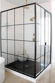 white and black shower with black hex tile shower floor