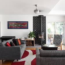example of an eclectic formal and enclosed medium tone wood floor and brown floor living room