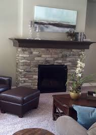 fireplace with stone mantle ht