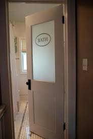 bathroom doors with frosted glass. vintage modern bathroom - love the frosted glass door! doors with 2
