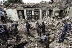 natural disaster unnatural suffering opendemocracy rescuers dig through the rubble 17 2015