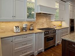 white kitchen cabinets with black countertops. Gray Mosaic Tile Backsplash Hardwood Kitchen Cabinets With White Accents And Glass Pendant Lights Black Countertop Countertops N