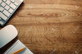Close up Computer Keyboard and Mouse , Pencil and Graphing Notebook on Top  of Wooden Desk