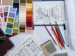 interior designer. Architects/ Interior Designer Desk With Laptop, Shop Drawing, Material Sample Royalty-free M