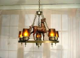 wagon wheel chandelier with mason jars wagon wheel chandelier light fixtures home design ideas about wagon