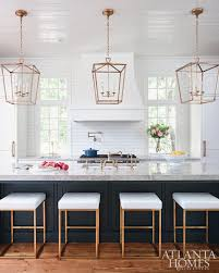 lighting above kitchen island. love the oversized island with thick countertop different color i donu0027t like brass fixtures lighting above kitchen t