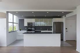 modern kitchen with absolute black granite slate countertop and stone  backsplash