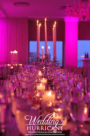 Gorgeous long table set up with pink uplighting for a wedding at Waterside  NJ Weddings in