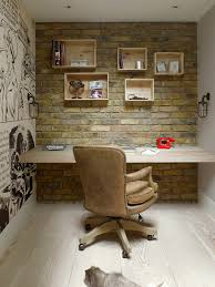 view in gallery home office with brick wall custom wooden shelves and comic strip styled wall art art for home office