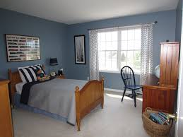Stripping Dining Room Table Blue Wall With Brown Wooden Bed Completed Gray Sheet Also F Black