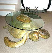 turtle coffee table in gilt bronze with top surface sea book