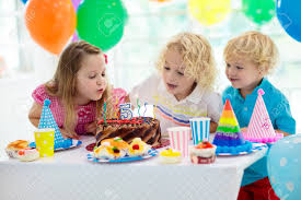 Child S Birthday Party Kids Birthday Party Child Blowing Out Candles On Colorful Cake