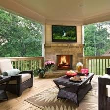 back porch expands to an outdoor living space with the addition of corner fireplace and big screen tv