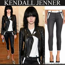 kendall jenner in black white trim crop jeans with black leather jacket new york fashion show