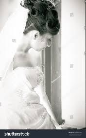 beautiful bride lin a window looking away from camera