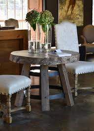 round sidetable with camphor top and dppe and iron base