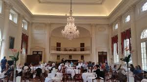 the pump room restaurant west side wall including chandelier and piano player