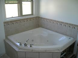 cool corner soaker tub with wall tile surround and window treatment also tile bathtub surround