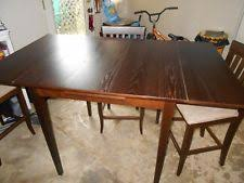pier one imports wood tall kitchen table w 3 chairs in used condition