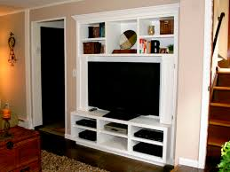 ... Living Room Entertainment Center Ideas Black Television And White Racks  Decorate Ornaments Stylish Interior Wool Brown ...