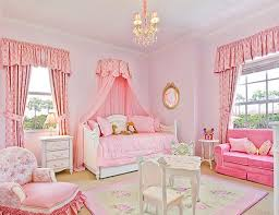 Bright Pink Bedroom With Canopy Beds